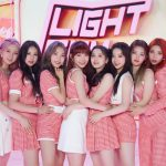 Image of Cube Entertainment's LIGHTSUM, an 8-member K-pop girl group dressed in pink and white checkered outfits and standing close together during their June 10 Debut Showcase.